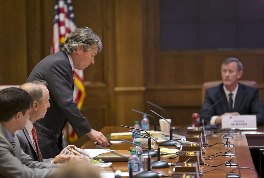 University of Texas Regent Wallace Hall (left, standing) sued UT System Chancellor Bill McRaven (right) for access to student admissions records he's been seeking to review for years.  (File 2015/Austin American-Statesman)
