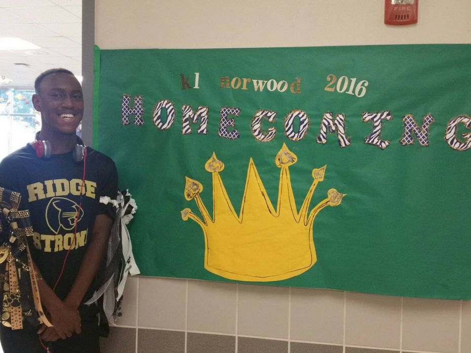 Keller Fossil Ridge High School's 2016 homecoming king K.L. Norwood poses next to a homecoming sign at his school (Courtesy/Staci Murto)