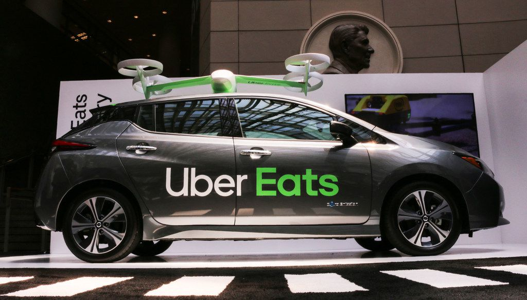 An Uber Eats car and drone was on display at the Uber Elevate Summit, too. Uber is testing food delivery service by drone. The drones will land on an Uber car and a courier will deliver the order to a customer's door.