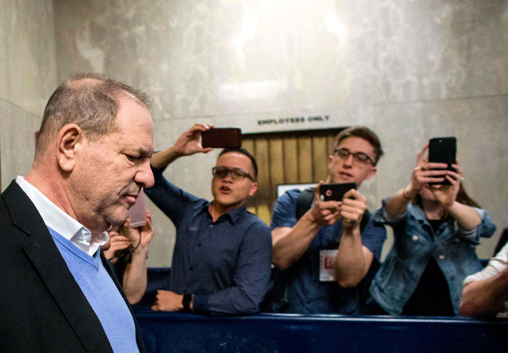 Harvey Weinstein leaves the Manhattan Criminal Court on Friday. Weinstein was arrested and charged Friday with rape and other sex crimes involving two separate women, New York police announced shortly after the fallen Hollywood mogul surrendered to authorities.