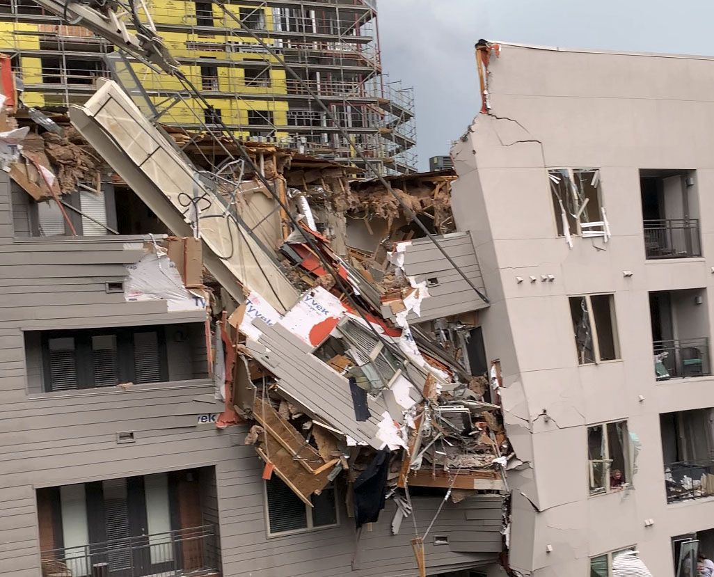 Injuries were reported after a crane fell into the Elan City Lights apartment building in Old East Dallas near downtown, as a severe storm passed through the area on Sunday afternoon, June 9, 2019.