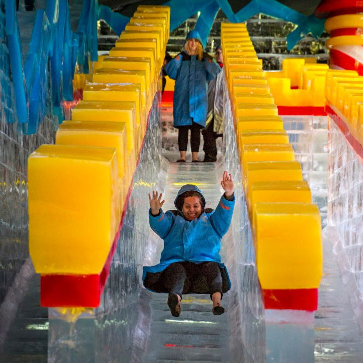Carla Lule tries out a slide at ICE!, the annual holiday attraction at the Gaylord Texan hotel.