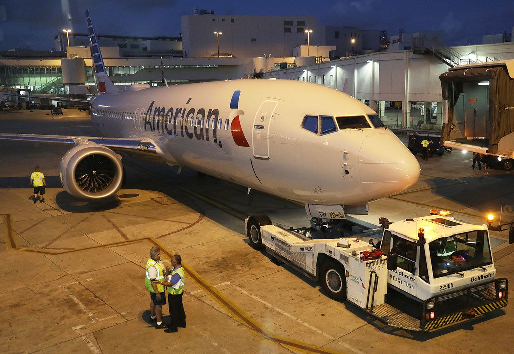 A grounded American Airlines Boeing 737 Max 8 is towed to another location at Miami International Airport.