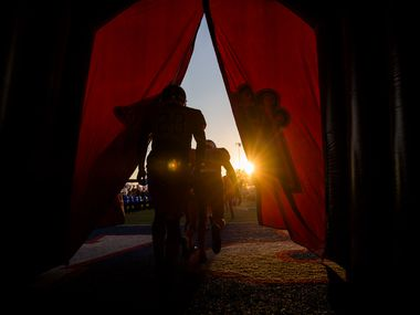Duncanville football players enter the field through an inflatable tunnel before a high school football game between Lancaster and Duncanville on Friday, August 31, 2018 at Panther Stadium in Duncanville, Texas. (Ashley Landis/The Dallas Morning News)
