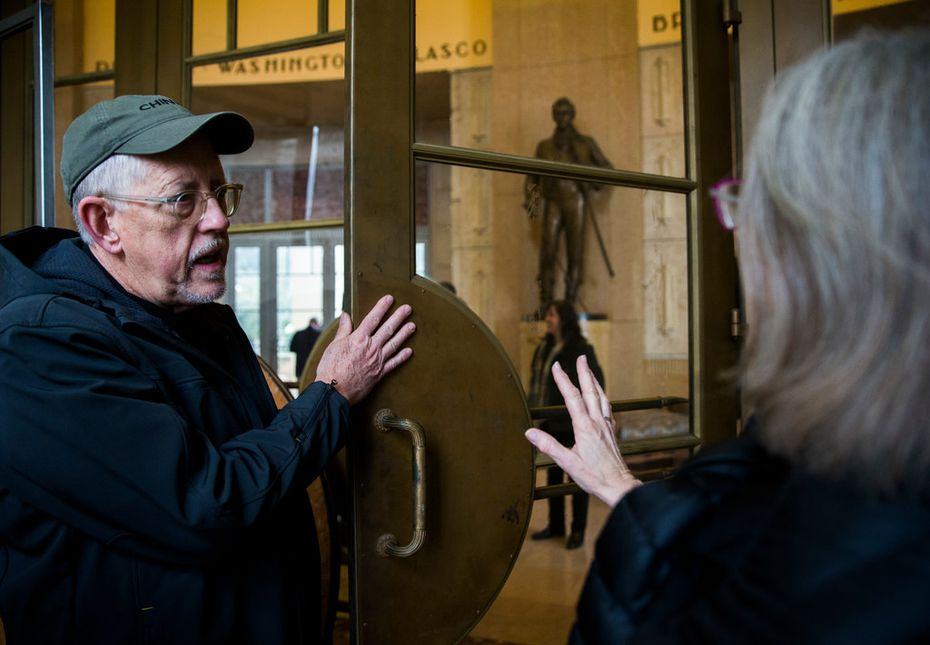 Willis Winters, director of Dallas Parks and Recreation, and Marcel Quimby of Gensler architecture firm talk about the original polish on a door inside the historic Hall of State building on March 1, 2019.