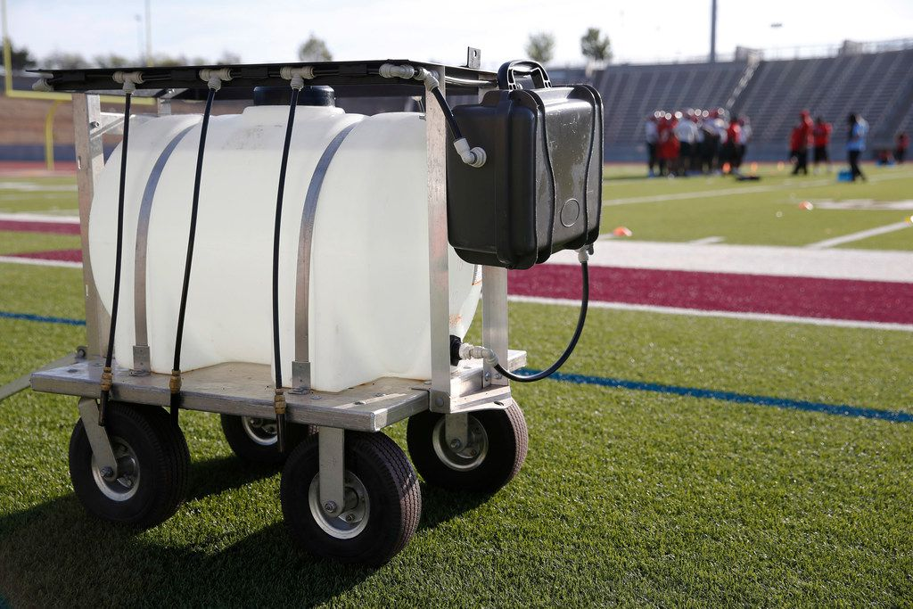 Water jug sits available for players as practice continues for the Carter High School football team at Kincaide Stadium in Dallas, on Monday, August 6, 2018. (Vernon Bryant/The Dallas Morning News)