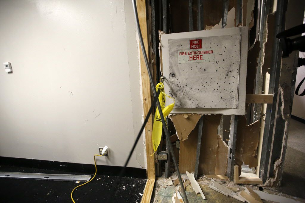 This is the spot where the gunman was cornered by police in a second story hallway at El Centro College in downtown Dallas, July 19, 2016. On their other side of this wall is a server room, left. The police detonated a bomb, killing the gunman and causing all the structural damage. (Tom Fox/The Dallas Morning News)