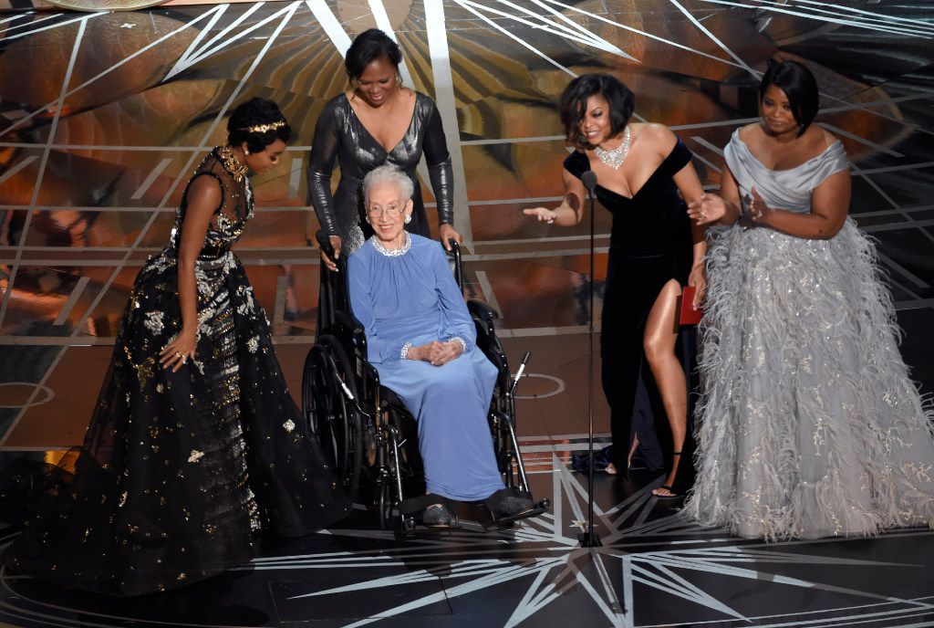 Janelle Monae (left), Taraji P. Henson (second right from right) and Octavia Spencer (right) introduced Katherine Johnson (seated), the inspiration for Hidden Figures, as they presented the award for best documentary feature at the Oscars on Sunday at the Dolby Theatre in Los Angeles. (Chris Pizzello/Invision)