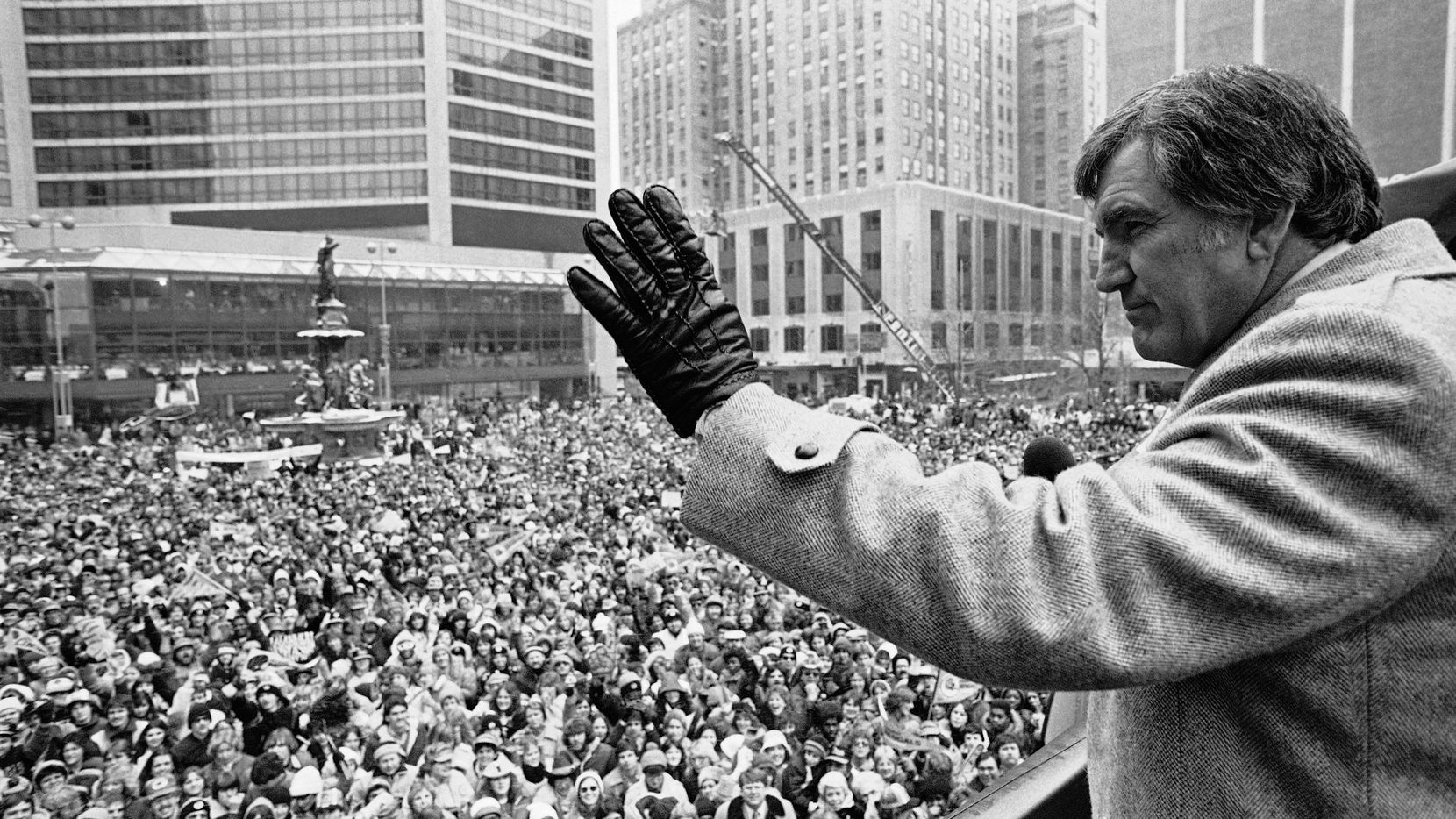 FILE - In this Jan. 25, 1982, file photo, Cincinnati Bengals head coach Forrest Gregg waves to the crowd in Cincinnati. The Bengals lost to the San Francisco 49ers in the Super Bowl the day before. The Pro Football Hall of Fame says Green Bay Packers great Forrest Gregg has died. He was 85. The Hall did not disclose details about his death in its statement Friday, April 12, 2019.(AP Photo/Ed Reinke, File)