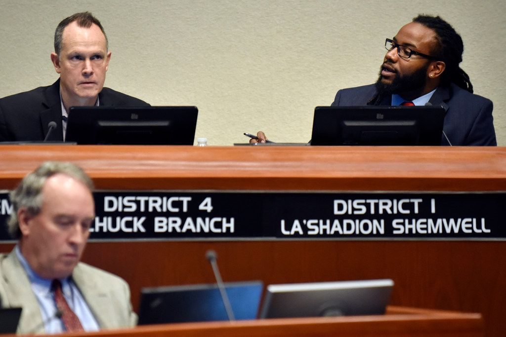 La'Shadion Shemwell (right) addresses the council during Tuesday's meeting as council member Chuck Branch (left) listens.