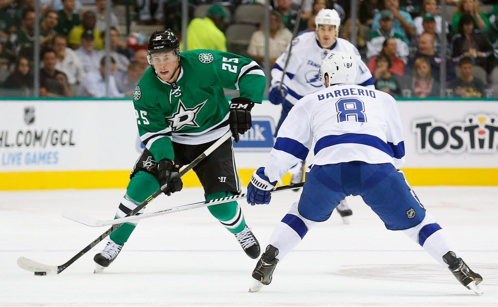 DALLAS, TX - SEPTEMBER 30: Brett Ritchie #25 of the Dallas Stars controls the puck against Mark Barberio #8 of the Tampa Bay Lightning in the first period of a preseason game at American Airlines Center on September 30, 2014 in Dallas, Texas.