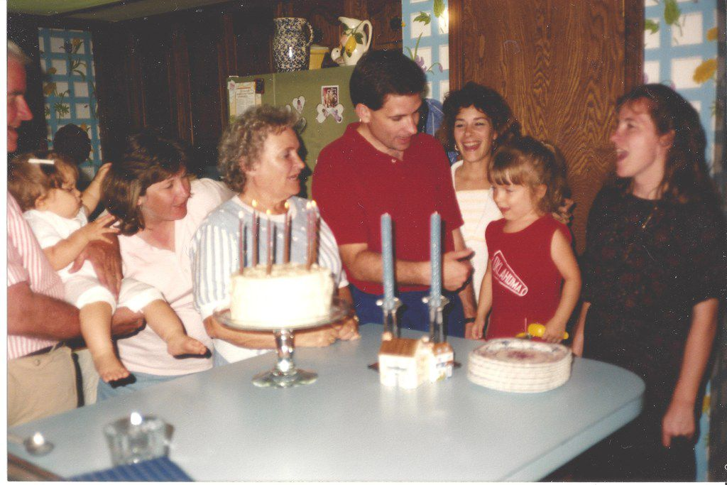 """Nancy McCall (center), Nanette Light's grandmother, sings """"Happy Birthday"""" to Light (second from right) with the rest of her family on her fourth birthday in 1991 during a celebration at McCall's home in Norman, Okla."""