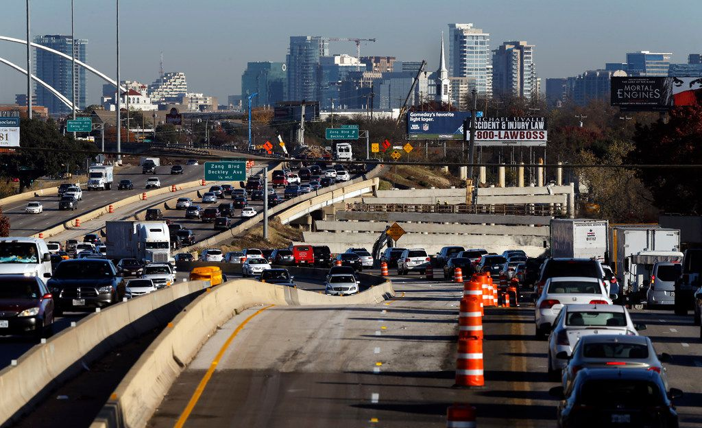 Morning rush hour traffic slows near Brookhaven Drirve, where new Interstate 35E bridge construction is happening in Oak Cliff.