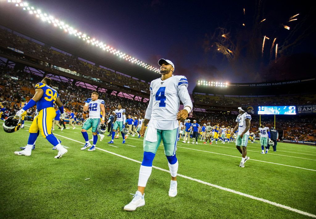 Dallas Cowboys quarterback Dak Prescott (4) walks off the field with fireworks after a 14-10 win over the Los Angeles Rams of an NFL preseason game on Friday, August 17, 2019 at Aloha Stadium in Honolulu, Hawaii.