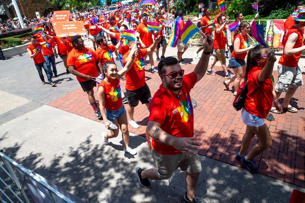 Parade-goers wave their flags during the annual Dallas Pride / Alan Ross Texas Freedom Parade at Fair Park in Dallas on Sunday, June 2, 2019. (Shaban Athuman/Staff Photographer)