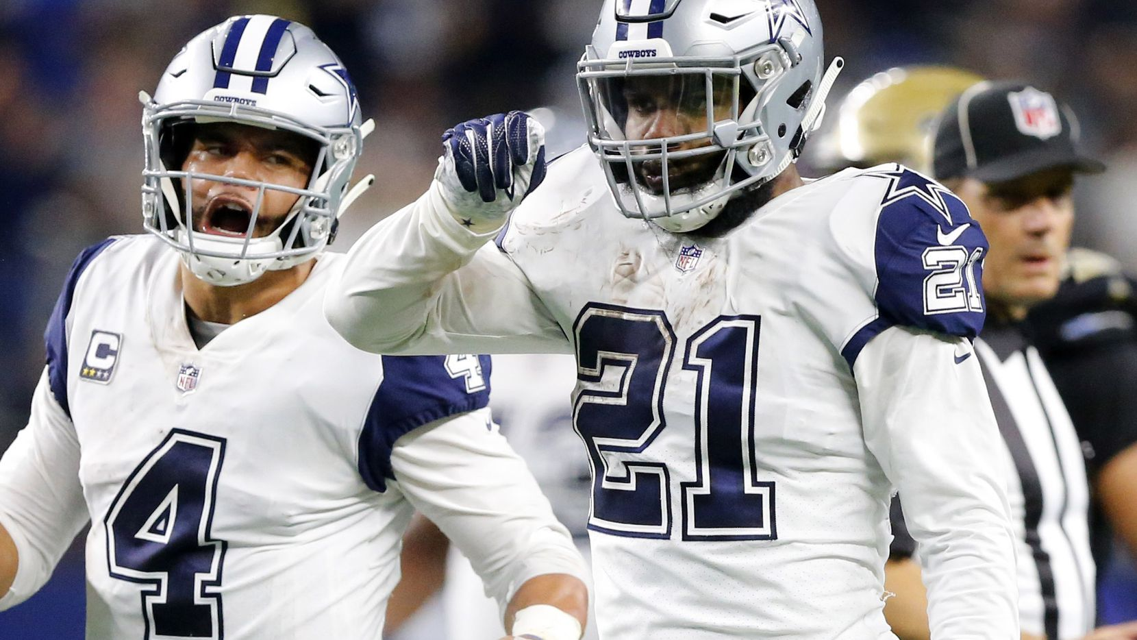 Dallas Cowboys running back Ezekiel Elliott (21) cel;rates his big final drive run with quarterback Dak Prescott (4) in the fourth quarter at AT&T Stadium in Arlington, Texas, Thursday, November 29, 2018. The Cowboys pulled out a 13-10 win. (Tom Fox/The Dallas Morning News)