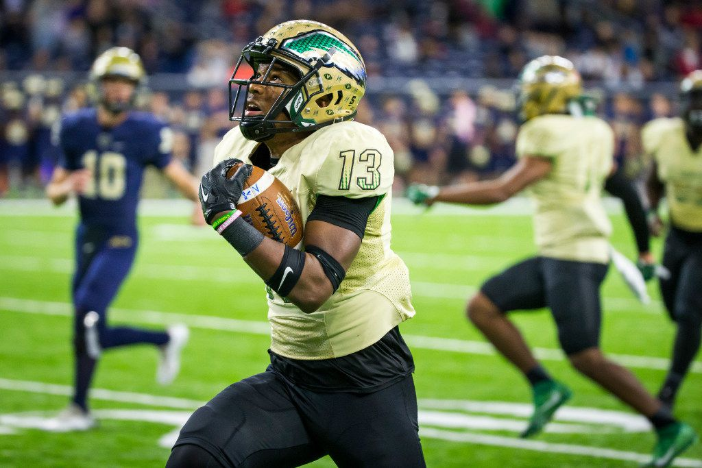 DeSoto defensive back Isaiah Stewart (13) races down the sidelines on a 42-yard fumble return for a touchdown during the second half of a UIL Class 6A Division II state semifinal playoff football game against Klein Collins at NRG Stadium on Saturday, Dec. 10, 2016, in Houston. (Smiley N. Pool/The Dallas Morning News)