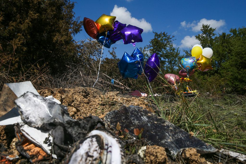 Balloons fly at the site of a memorial where one student died Wednesday when a Mesquite ISD school bus rolled into a ditch with 40 students on board in the 3500 block of Lawson Road on Thursday, Oct. 4, 2018, in Mesquite, Texas.