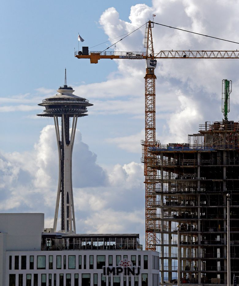 Amazon occupies 40 buildings in downtown Seattle. It has one building under construction and another in the planning phase. Amazon said on Wednesday that it's pausing the planning on one building as a protest to a head tax that the Seattle City Council may vote on in late May 2018. (AP Photo/Elaine Thompson, File)