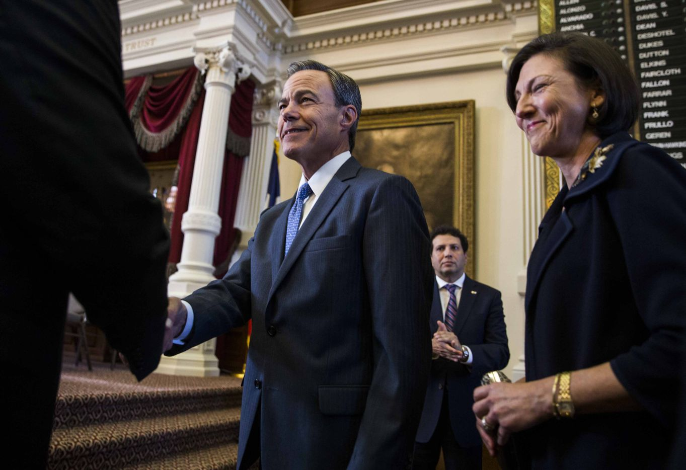 Texas State Rep. Joe Straus and his wife, Julie Brink, take the stage after Straus was elected as Speaker of the House during the first day of the 85th Texas Legislative Session on Tuesday at the Texas State Capitol in Austin.