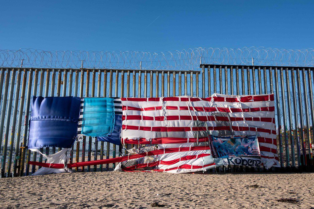 A patchwork representing a US flag hangs on the US-Mexico border in Playas de Tijuana, Baja California State, Mexico, on March 8, 2019. - March 10, 2019 will mark the first 100 days of Mexican President Andres Manuel Lopez Obrador in power. Lopez Obrador has a surprisingly warm rapport with US President Donald Trump, despite the US president's border wall obsession and attacks on immigrants. (Photo by GUILLERMO ARIAS / AFP)GUILLERMO ARIAS/AFP/Getty Images