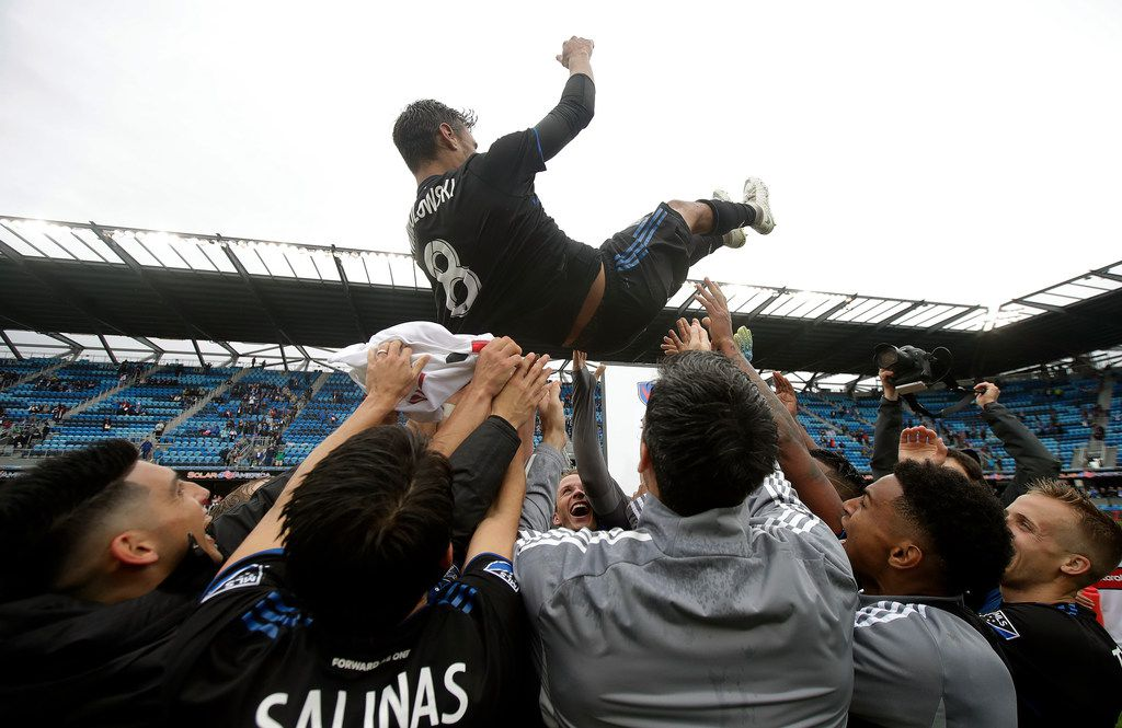 San Jose Earthquakes forward Chris Wondolowski, top, is hoisted by teammates after they defeated the Chicago Fire in an MLS soccer match in San Jose, Calif., Saturday, May 18, 2019. Wondolowski scored four times to pass Landon Donovan for most career MLS goals. (AP Photo/Jeff Chiu)