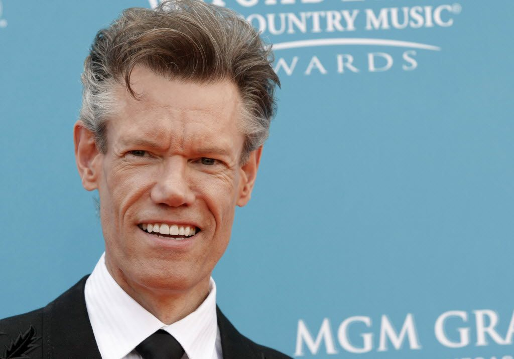 "FILE - This April 18, 2010 file photo shows singer Randy Travis at the 45th Annual Academy of Country Music Awards in Las Vegas. Travis suffered a stroke in 2013 and is now releasing a memoir and appeared on the ""Today"" show on NBC."