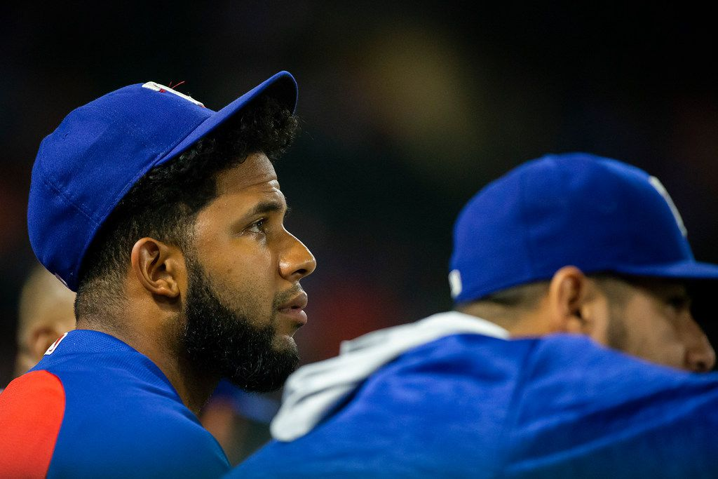 Texas Rangers shortstop Elvis Andrus watches from the dugout during the ninth inning of a 5-2 loss to the Houston Astros at Globe Life Park on Thursday, June 7, 2018, in Arlington. (Smiley N. Pool/The Dallas Morning News)