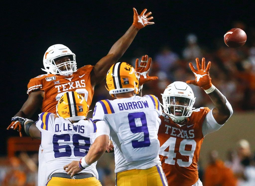 Texas Longhorns linebacker Jeffrey McCulloch (23) and defensive lineman Ta'Quon Graham (49) attempt to block a pass by LSU Tigers quarterback Joe Burrow (9) during the fourth quarter of a college football game between the University of Texas and Louisiana State University on Saturday, Sept. 7, 2019 at Darrell Royal Memorial Stadium in Austin, Texas. (Ryan Michalesko/The Dallas Morning News)