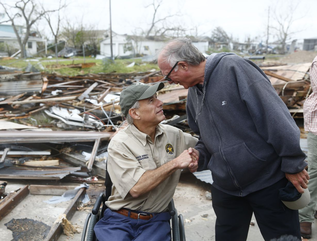 County Judge Todd Hunter (right) shakes hands with Texas Gov. Greg Abbott as he visits Rockport after Hurricane Harvey in Rockport, Texas on Aug. 28, 2017.