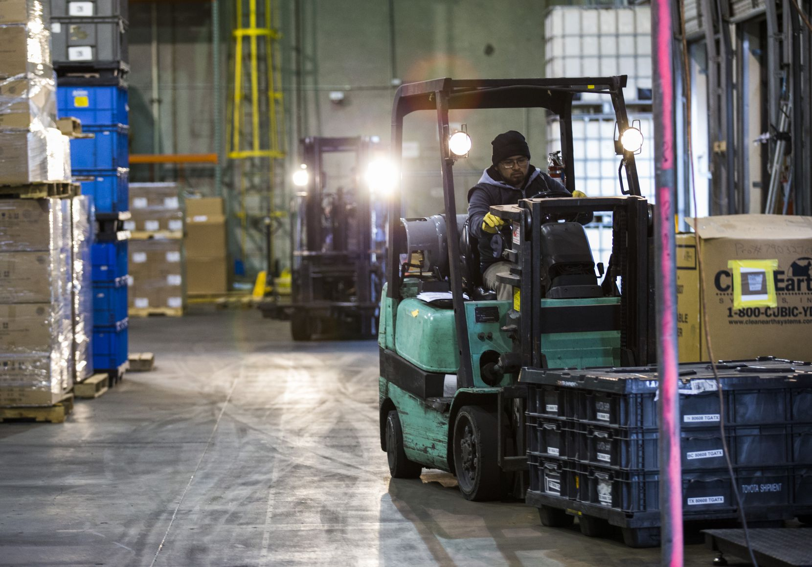 Francisco Garza drives a forklift through the Bespoke-Logistics warehouse in January, 2018 in McAllen, Texas. The warehouse acts as a mid-point for shipments going to and from the U.S. and Mexico.