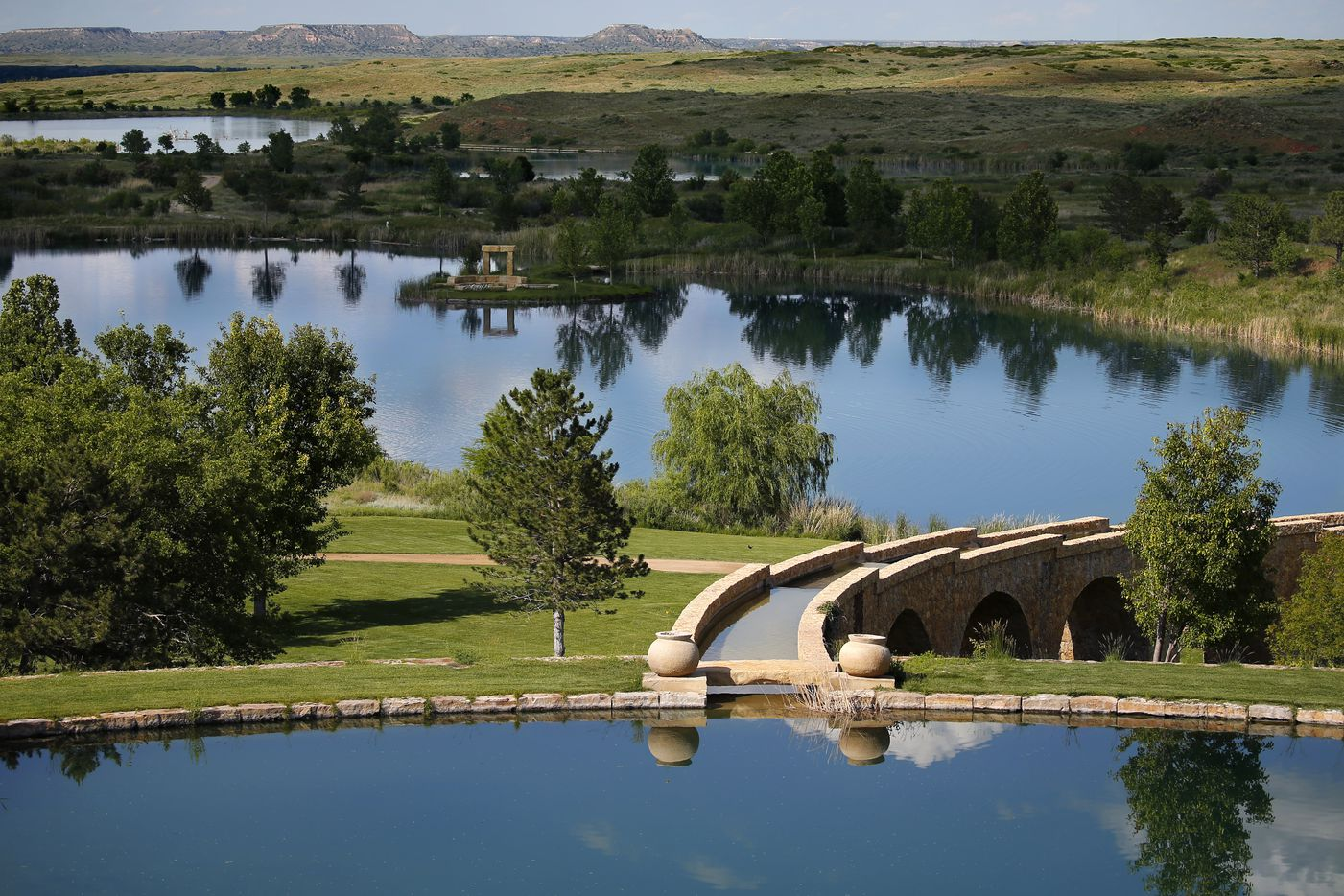 An aqueduct leads from one man-made lake to the next.  The series of lakes, fed by the Ogallala Aquifer, runs through the 68,000-acre Mesa Vista Ranch.