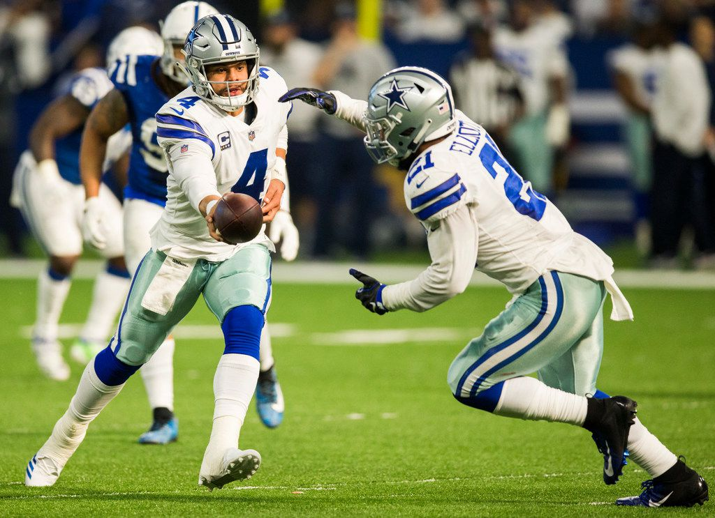 Dallas Cowboys quarterback Dak Prescott (4) hands off the ball to running back Ezekiel Elliott (21) during the second quarter of an NFL game between the Dallas Cowboys and the Indianapolis Colts on Sunday, December 16, 2018 at Lucas Oil Stadium in Indianapolis, Indiana. (Ashley Landis/The Dallas Morning News)