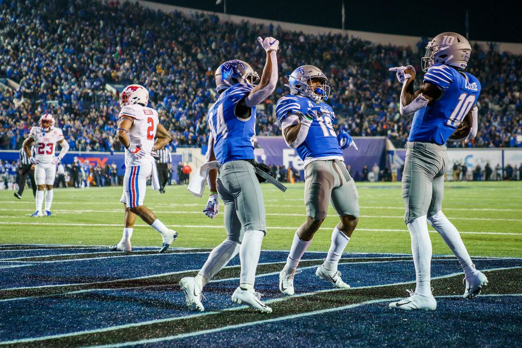 Memphis wide receiver Damonte Coxie (10) celebrates with wide receiver Antonio Gibson (14) and running back Kenneth Gainwell (19) after hauling in a 24-yard touchdown pass as SMU safety Patrick Nelson (2) and safety Rodney Clemons (23) look away during the second half of an NCAA football game at Liberty Bowl Memorial Stadium on Saturday, Nov. 2, 2019, in Memphis, Tenn. (Smiley N. Pool/The Dallas Morning News)
