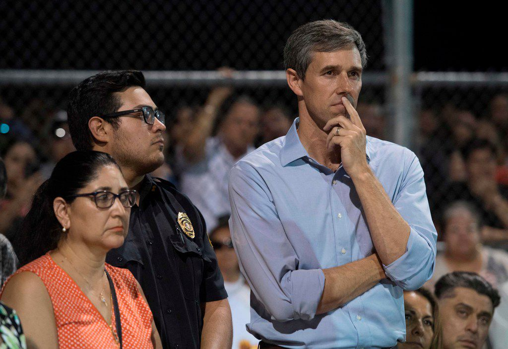 Beto O'Rourke  looks on before speaking at a prayer and candle vigil in El Paso on Aug. 4, 2019, the day after a shooting left 22 people dead at a local Walmart.