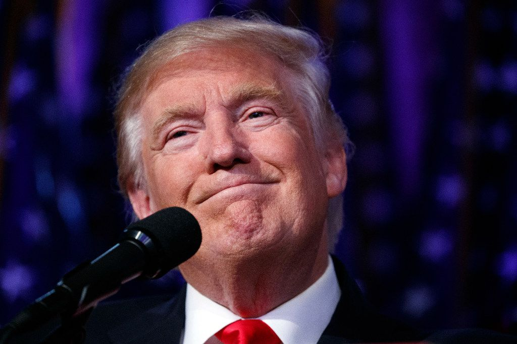 FILE - In this Wednesday, Nov. 9, 2016 file photo, President-elect Donald Trump smiles as he arrives to speak at an election night rally, in New York. Late-night hosts combined punchlines and audience therapy as they addressed Trump's victory. Conan O'Brien asked his audience Wednesday if anyone needed a hug, then joked he called his old high school bully to congratulate him. (AP Photo/Evan Vucci)