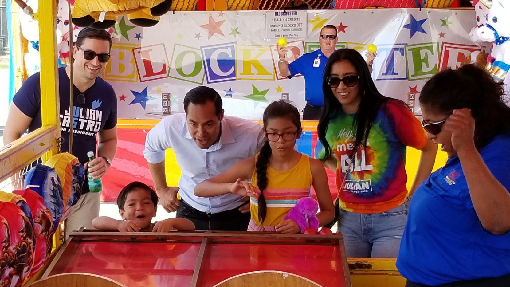Cristián Castro, 4, and his sister Carina, 10, play Rainbow Roll at the Iowa State Fair on Aug. 9, 2019, as parents Julián and Erica Castro look on.