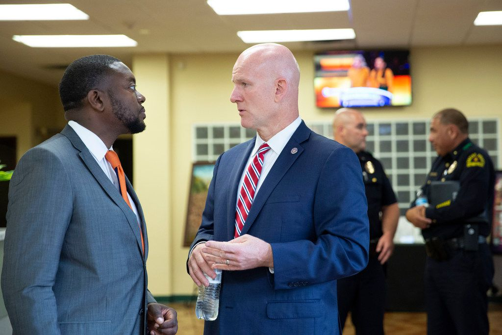 Community resident Daniel Davis Clayton (left) speaks with regional director of the Texas Department of Public Safety, Region 1, Jeoff Williams (CQ) (right), following a community meeting at Martin Luther King, Jr. Community Center in Dallas, Texas, Monday, August 5, 2019.