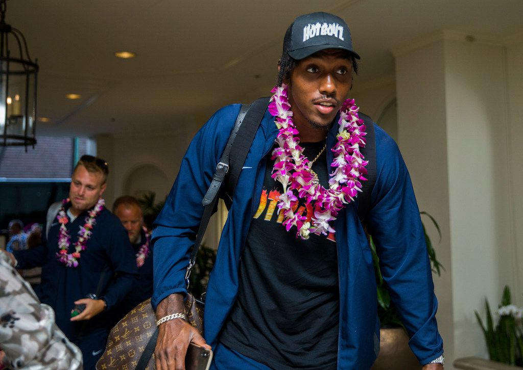 Dallas Cowboys defensive end Taco Charlton (97) and team mates arrive at the Westin Moana Surfrider hotel in Honolulu, Hawaii on Thursday, August 15, 2019. The Cowboys will take on the Los Angeles Rams in a preseason NFL game on Saturday. (Ashley Landis/The Dallas Morning News)