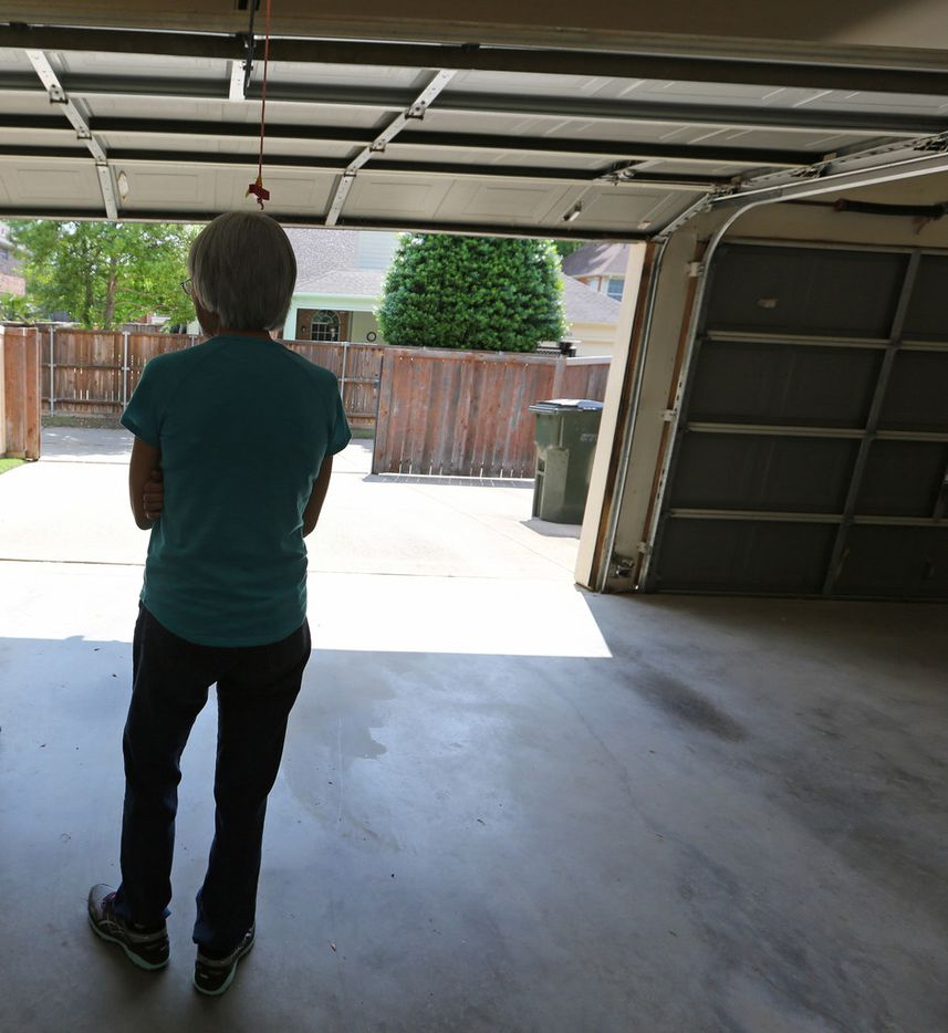 Cindy Collinvitti, widow of Christopher Collinvitti, stands in the garage near the spot where her husband was shot and killed in November 2017 at their Plano home. Police are seeking the public's help to solve the crime.