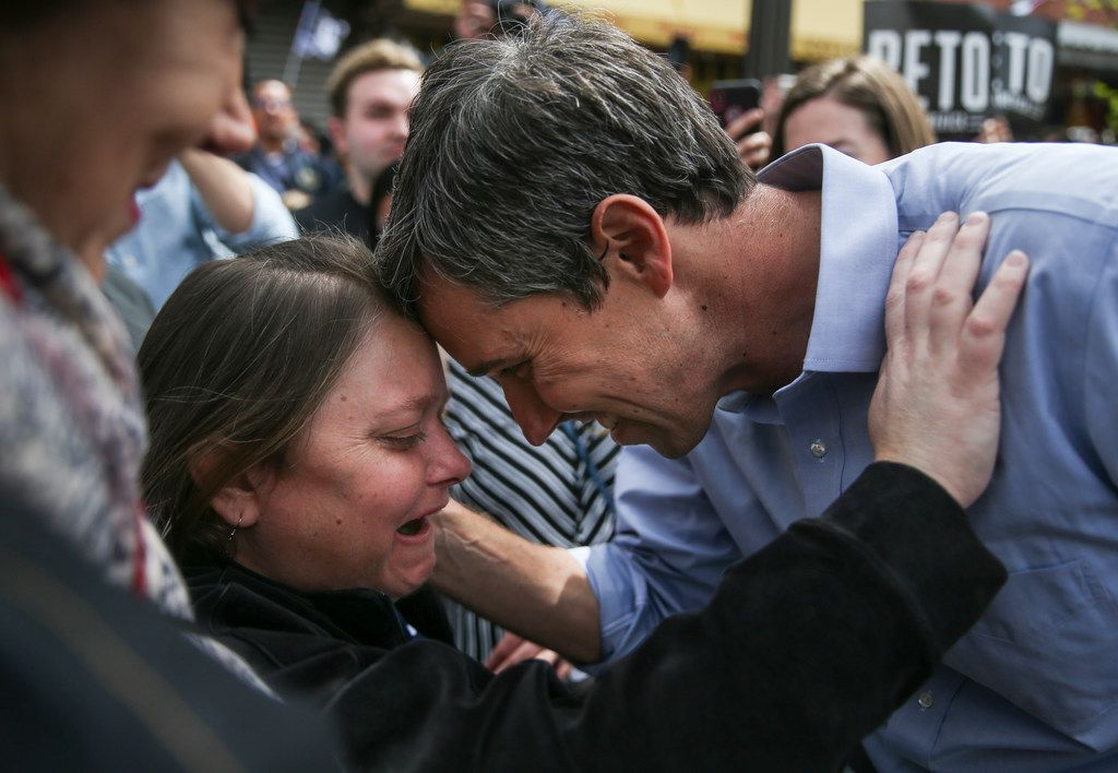 Beto O'Rourke embraces his sister, Erin O'Rourke, after speaking at a presidential campaign kickoff rally in downtown El Paso on Saturday.