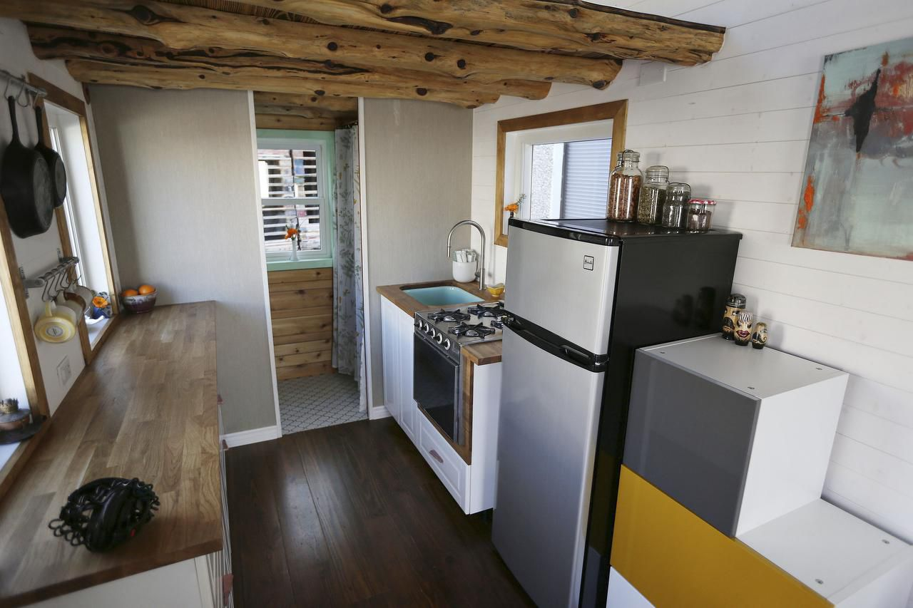A view of the kitchen inside the tiny house built by Randi Hennigan and her husband, Cody Hennigan, which is parked at the Lakewood Brewing Company, in Garland, Texas Wednesday February 24, 2016. The Hennigans started building the house in March 2015. The 170 square foot home includes reclaimed wood floors, a projector screen for entertainment and a wood burning stove. (Andy Jacobsohn/The Dallas Morning News)
