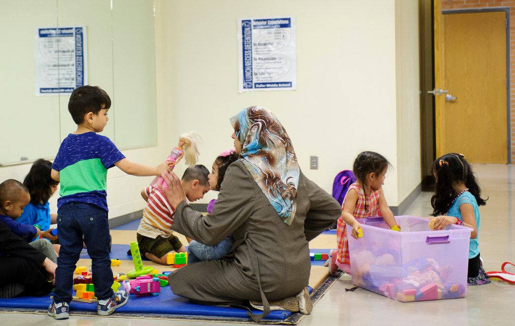 Children enjoy a playtime session provided by Lincoln Literacy, which offers free daycare during ESL classes, and free rides to Culler Middle School in Lincoln, Neb. on Wednesday, July 12, 2017. Lincoln Literacy is a nonprofit formed to teach the English language to immigrants and refugees arriving in Lincoln.