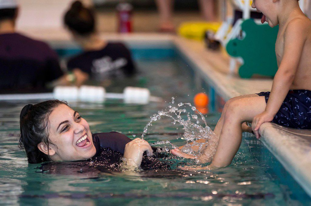 Teacher Leticia Martinez works with a youngster at Emler Swim School in Frisco.