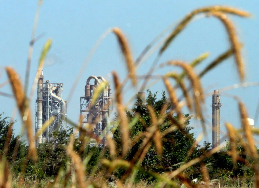 The Holcim Cement Plant is neighbor to the Mockingbird Nature Park as seen from one of the tour trails. The guided wildflower tour, aimed at educating enthusiasts  in the ability to identify native wildflowers, was conducted by members of the Indian Trail Chapter of the Texas Master Naturalist Program at the Mockingbird Nature Park in Midlothian on July 12, 2014. (Steve Hamm/Special Contributor)