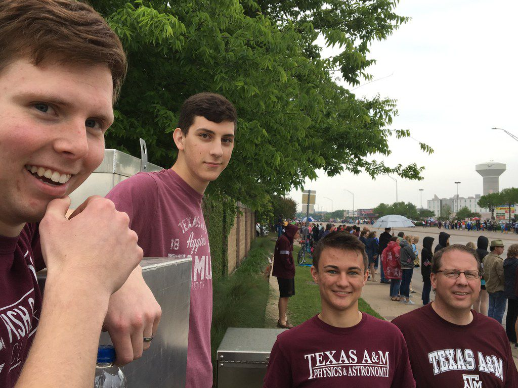 From left: Ryan Clark, Nathaniel Fasolino, Trent Jolie and Bruce Clark posed moments before former first lady Barbara Bush's casket traveled past a busy intersection on Saturday in College Station.