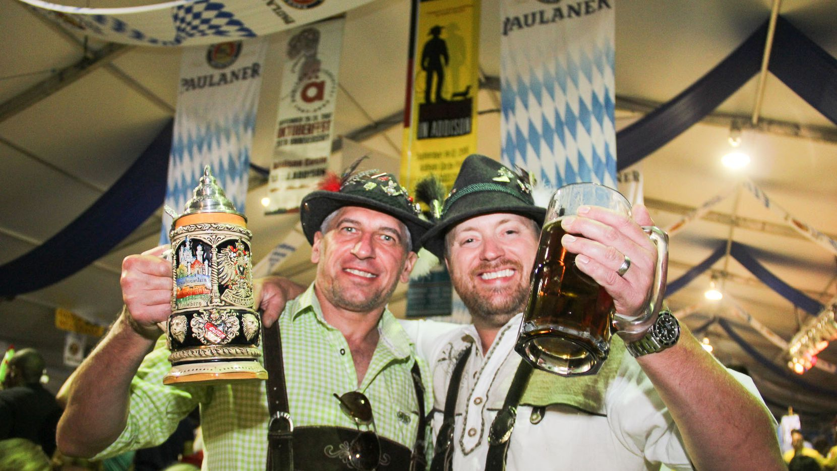 Antomio Cchirca and Paul Grein enjoyed the beer at Oktoberfest in Addison last year. The festival featured a midway with rides and live music brats and beer.