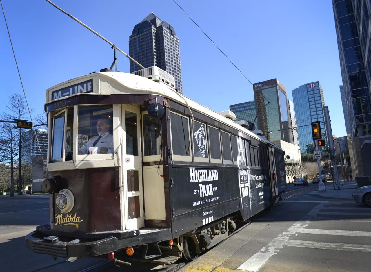 Brian Hench operates Matilda, one of the two McKinney Avenue trolleys that are wrapped in advertising. Some say the liquor ads make them uncomfortable.