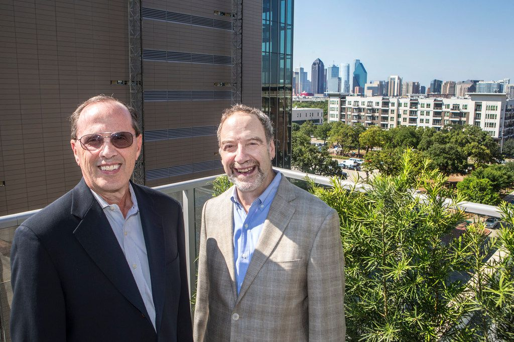 Forest City senior vice president Jim Truitt (left) and Brian Ratner, the company's Texas president, pose for a photograph near the pool.