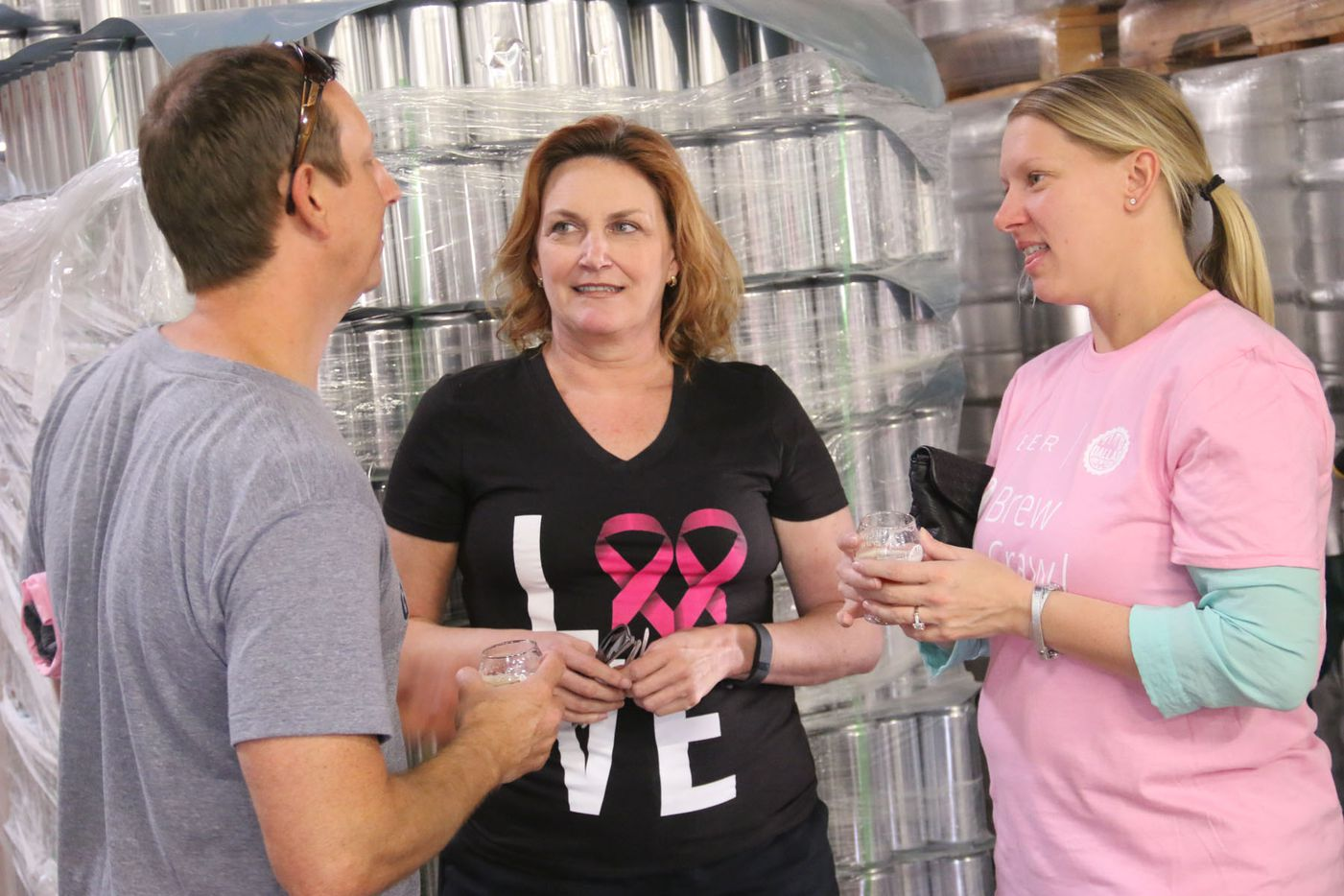 Kevin Vowell, Susan McClure and Kim Vowell  at Noble Rey Brewing Co. during the inaugural Brew Crawl for Breast Cancer on Saturday in Dallas.